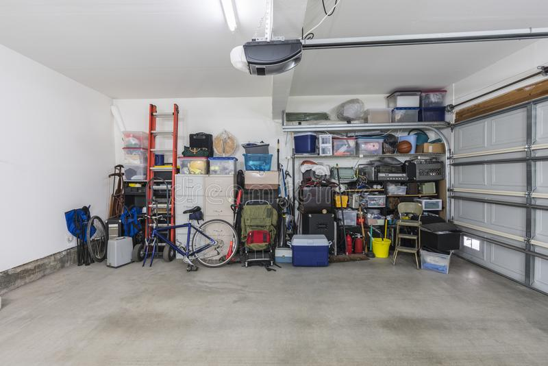 Cluttered but Organized Suburban Garage. Cluttered but organized clean suburban residential two car garage with tools, file cabinets and sports equipment royalty free stock image
