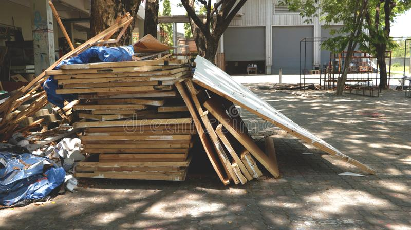 Cluttered Pile of Woods in Outdoor Garage/ Junk Yard/ Abandoned Garden stock photography