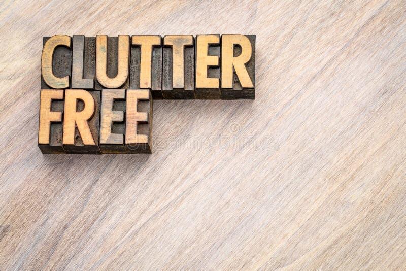 Clutterfree - sumário da palavra no tipo da madeira do vintage fotos de stock royalty free