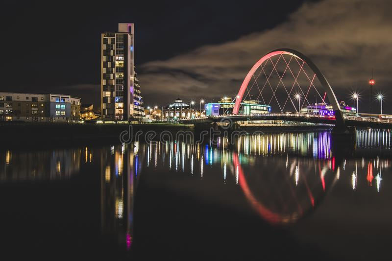 The Clyde Arc and light reflections at night. Glasgow Scotland royalty free stock image