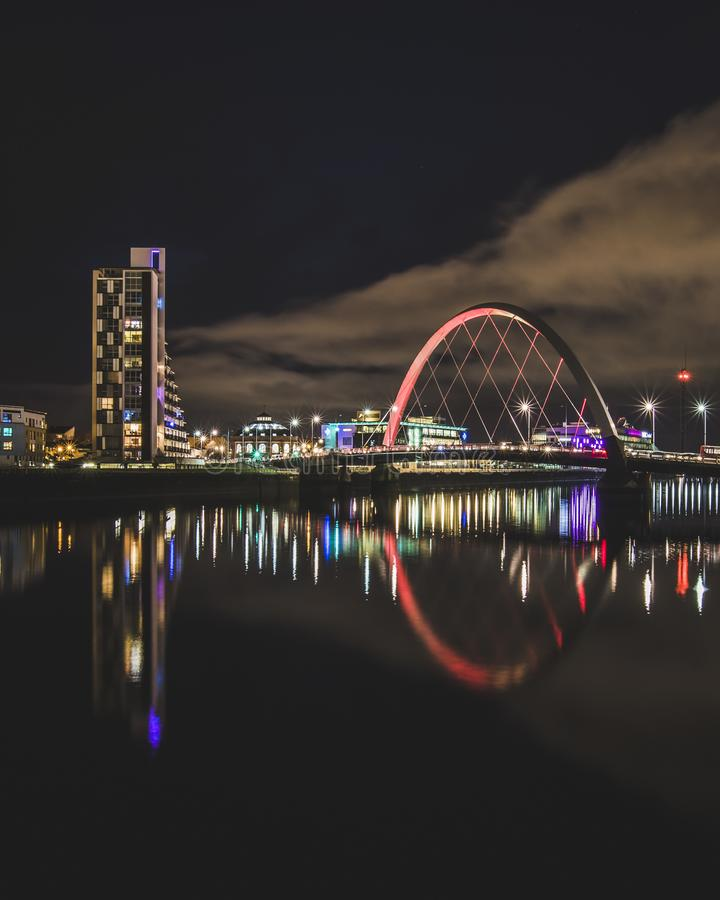 The Clyde Arc and light reflections at night. Glasgow Scotland royalty free stock photo