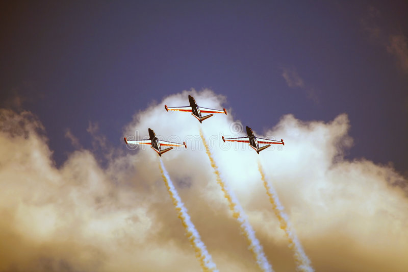 CM170 Jets. Three French CM170 jets soar in the sky, leaving trails of white smoke behind them stock photography