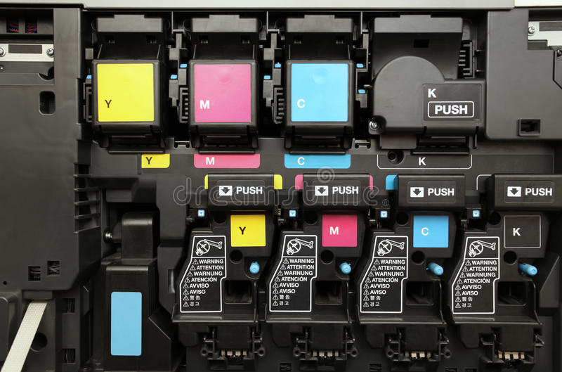 CMYK激光影印机设备的墨盒 图库摄影
