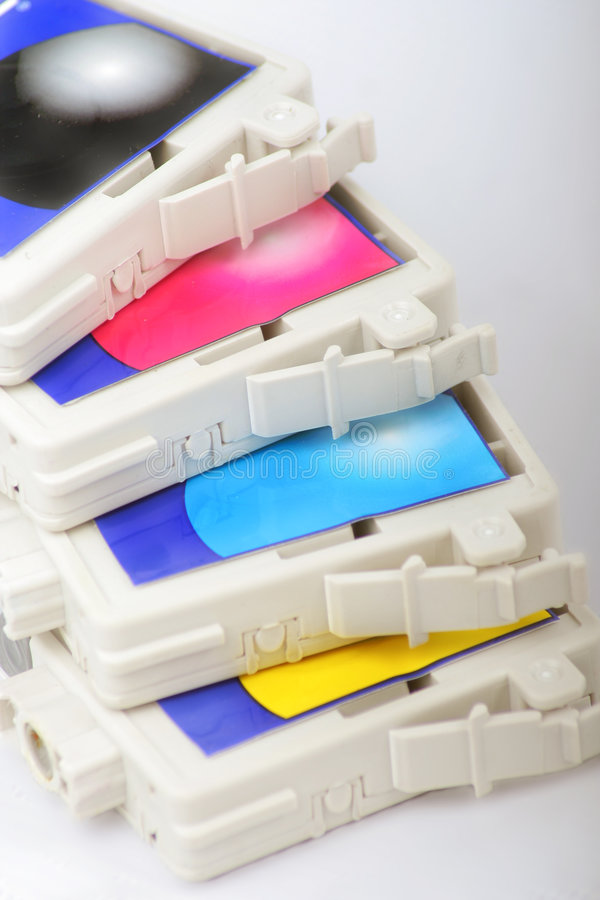 Cmyk color inkjet printer cartridge royalty free stock photos