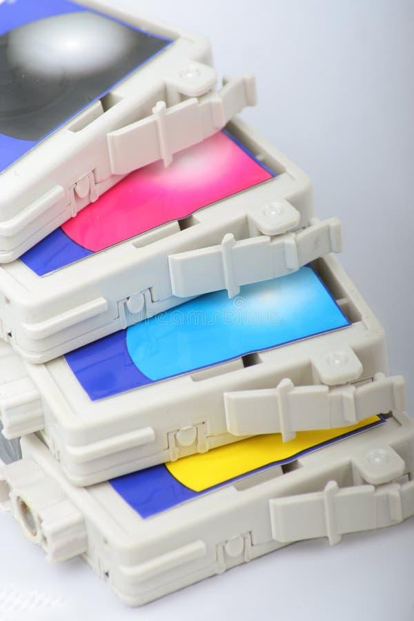 Cmyk color inkjet printer cartridge stock photo