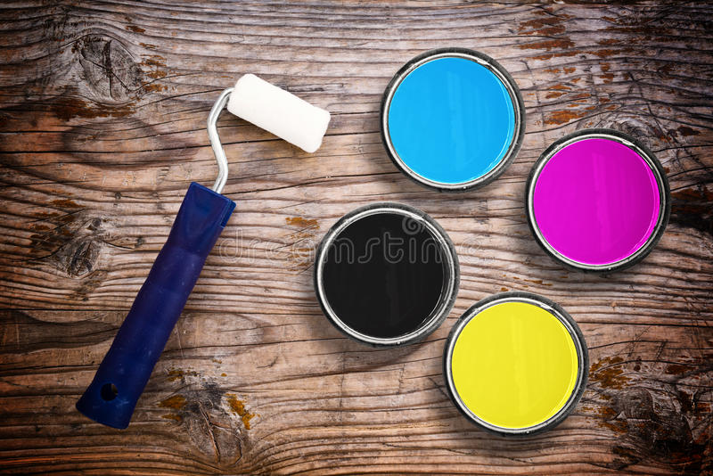 CMYK colors in tin cans stock images