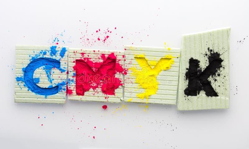 CMYK colour toner for printer cyan magenta yellow. On white background stock photo