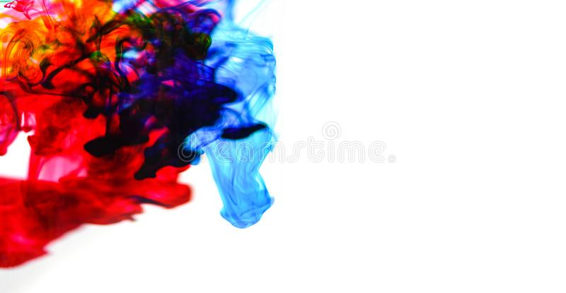 Cmyk ink concept color splash for paint / Rainbow ink drop Acrylic colors in water on white background stock photos