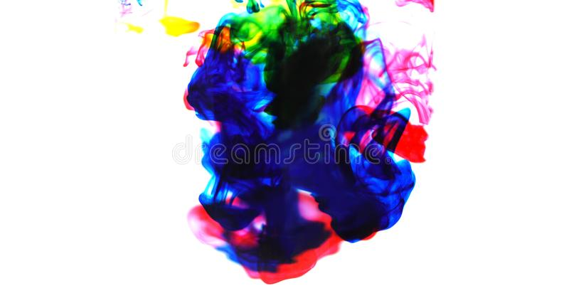 Cmyk ink concept color splash for paint - Rainbow ink drop Acrylic colors in water on white background , blur and selective focus royalty free stock photography