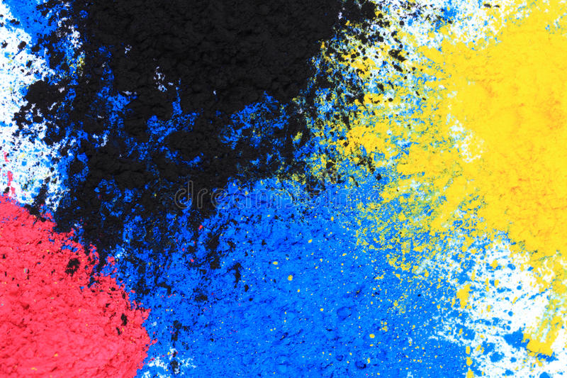 Cmyk toner powder (cyan, magenta, yellow, black) royalty free stock photo