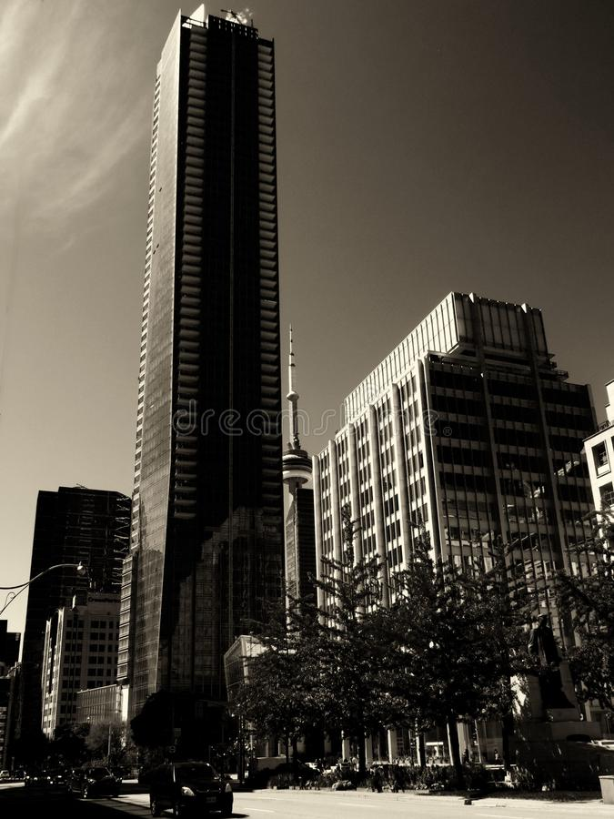 CN Tower in the Distance with tall Building in Monochrome. The Toronto CN Tower at the back with tall residential building in the foreground in downtown Toronto royalty free stock photos
