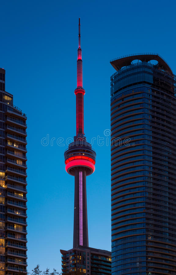 CN Tower in Toronto Canada. Illuminated CN Tower in Toronto, Ontario, Canada around dusk royalty free stock images