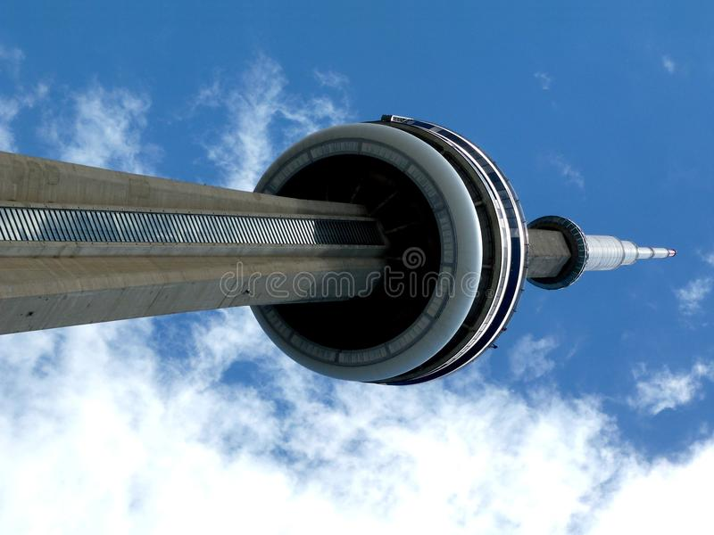 CN Tower Under Blue Sky. CN Tower communication tower in Toronto in perspective against blue sky royalty free stock photography