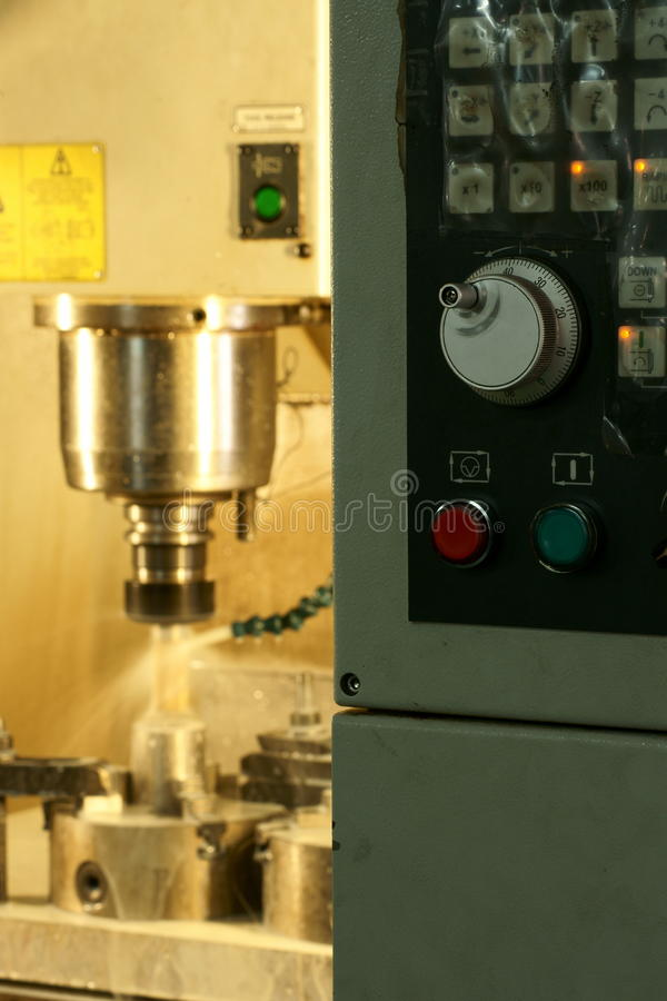 CNC control panel. CNC milling machine control panel with process running background stock photography