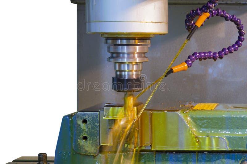 CNC della fresatrice con il liquido refrigerante dell'olio fotografie stock