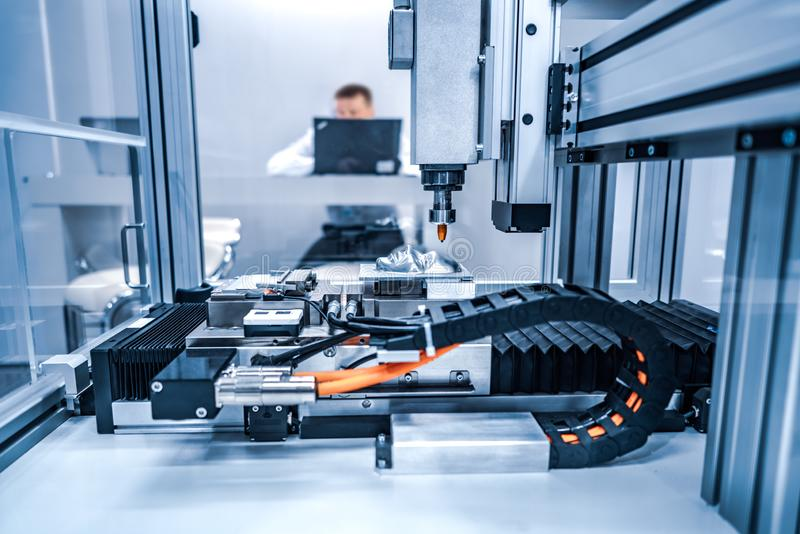 CNC Laser cutting of metal, modern industrial technology. Small depth of field. Warning - authentic shooting in challenging conditions royalty free stock images