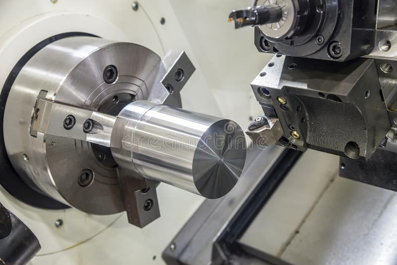 The CNC lathe machine clamping steel rod . stock photos