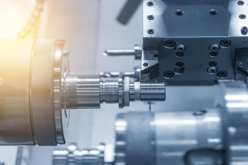 The CNC lathe machine or Turning machine. The CNC lathe machine Turning machine while drilling the metal rod with the drill and center drill tool .The hi royalty free stock image