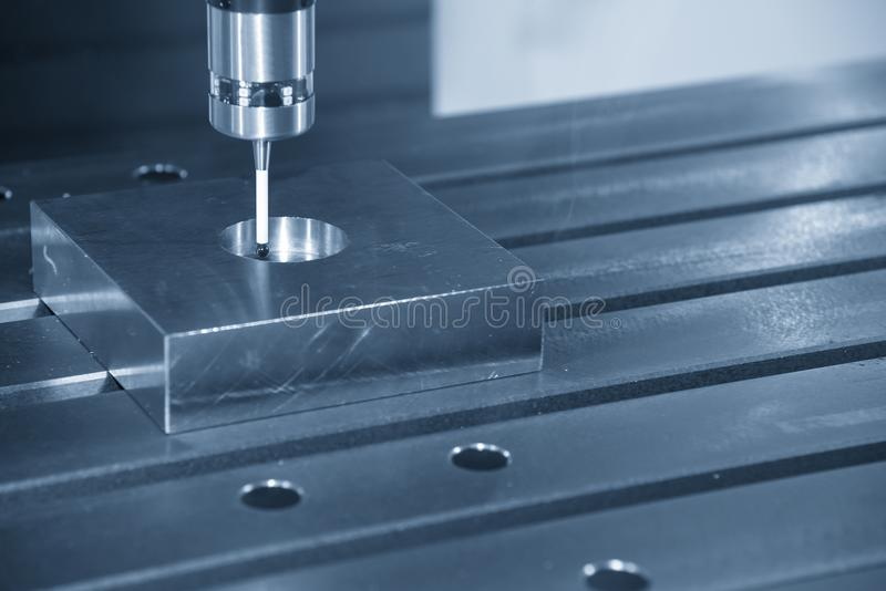 The CNC machine attach the CMM probe. Measure the dimension of circular hole royalty free stock photography