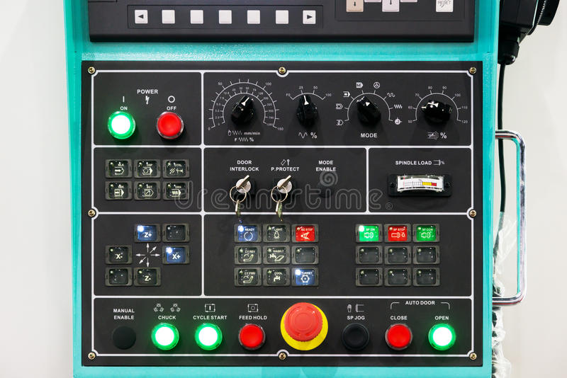 CNC machine control panel texture with lots of buttons in factor. Y stock image