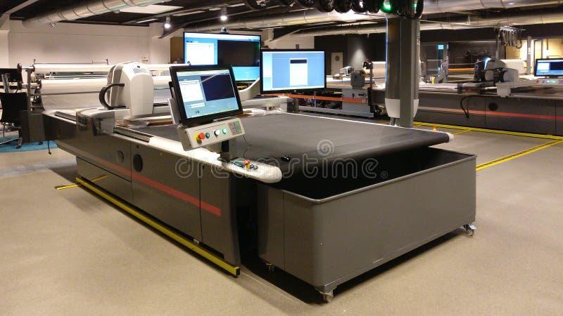 CNC machine for cutting fabrics textile stock images