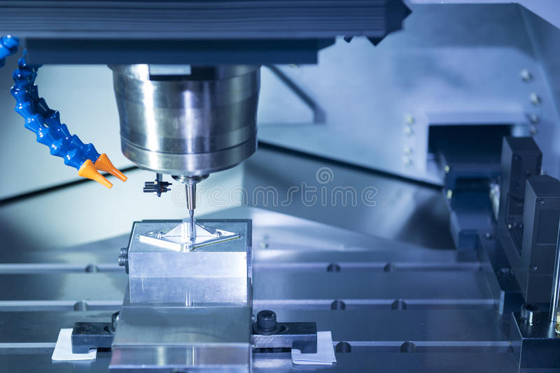 The CNC machine cutting work piece. The hi-precision machining process concept stock photography