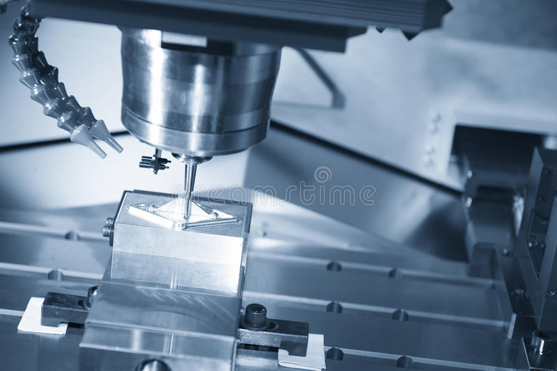 The CNC machine cutting work piece. And the measurement probe in magazine.The hi-quality machining process concept royalty free stock photos
