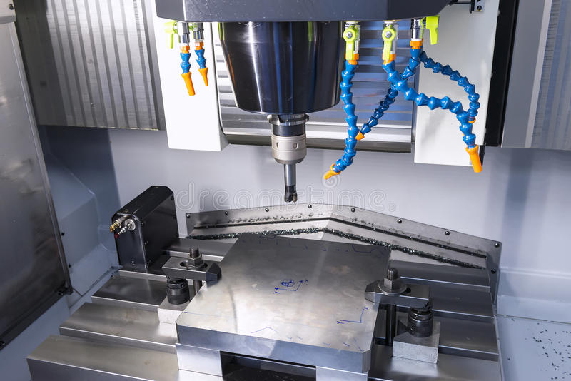 The CNC machine while prepare cutting sample work piece. The Vertiacal Milling CNC machine with indexable cutting tool and sample work piece stock photography