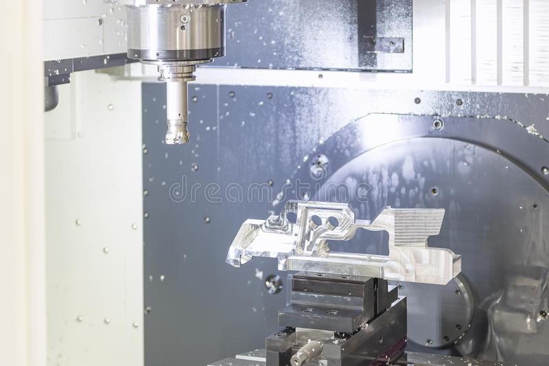 The CNC machine while prepare cutting sample. Work piece.The Vertiacal Milling CNC machine with indexable cutting tool and sample work piece stock photography