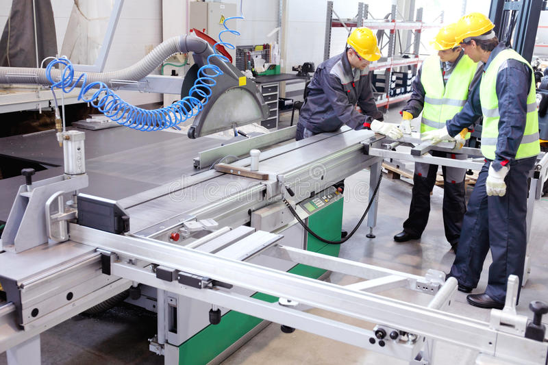 CNC machine shop. With lathes, technicians and workers royalty free stock photo