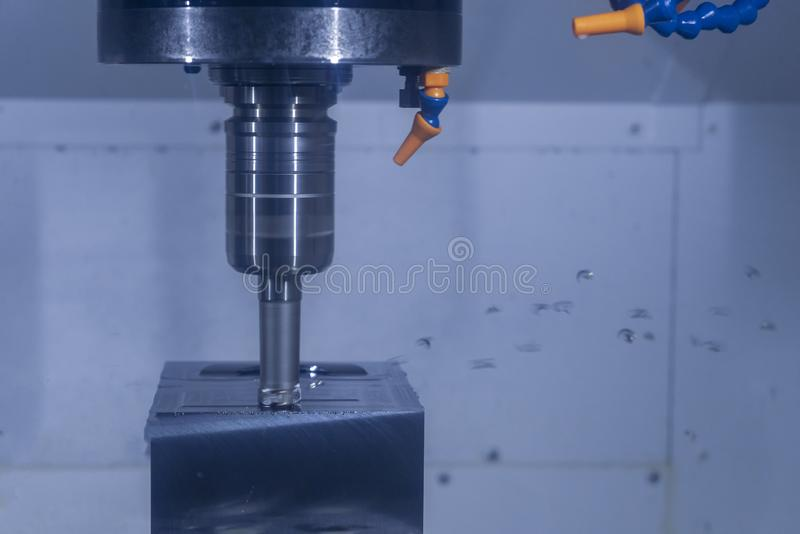 CNC machine tool cutting raw material in factory royalty free stock photos