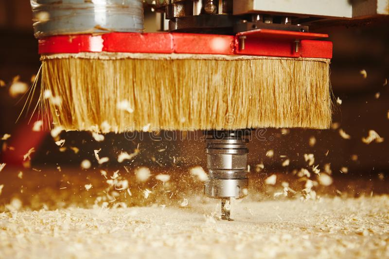 Cnc machine working, cutting wood. Woodwork industry. Device with computer numerical control, various router bits stock photos