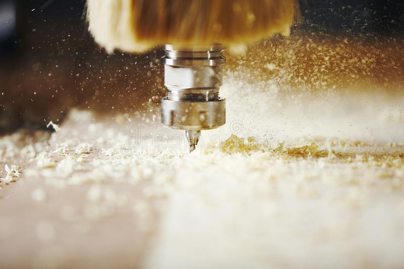 Cnc machine working, cutting wood. Woodwork industry. Device with computer numerical control, various router bits royalty free stock photos