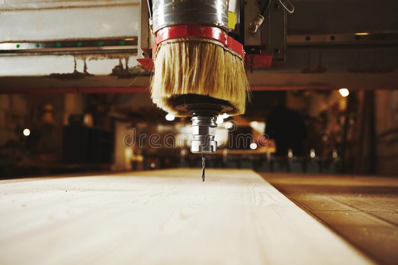 Cnc machine working, cutting wood. Woodwork industry. Device with computer numerical control, various router bits stock photo