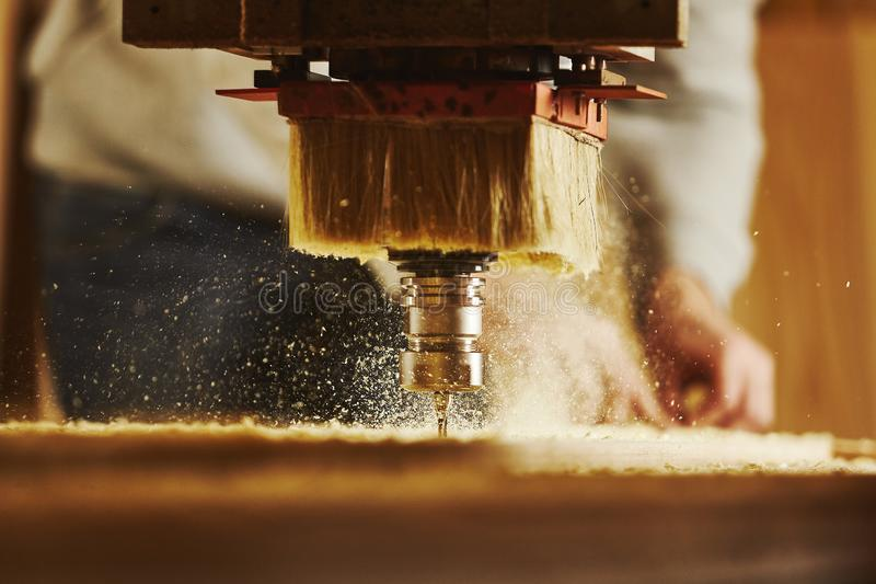Cnc machine working, cutting wood. Woodwork industry. Device with computer numerical control, various router bits royalty free stock image