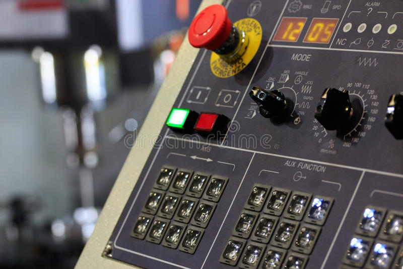 Cnc milling center. CNC machining center with operator panel on foreground royalty free stock photos