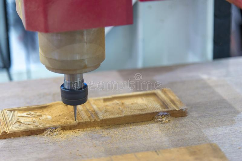 The CNC milling cutting the wood material. royalty free stock images