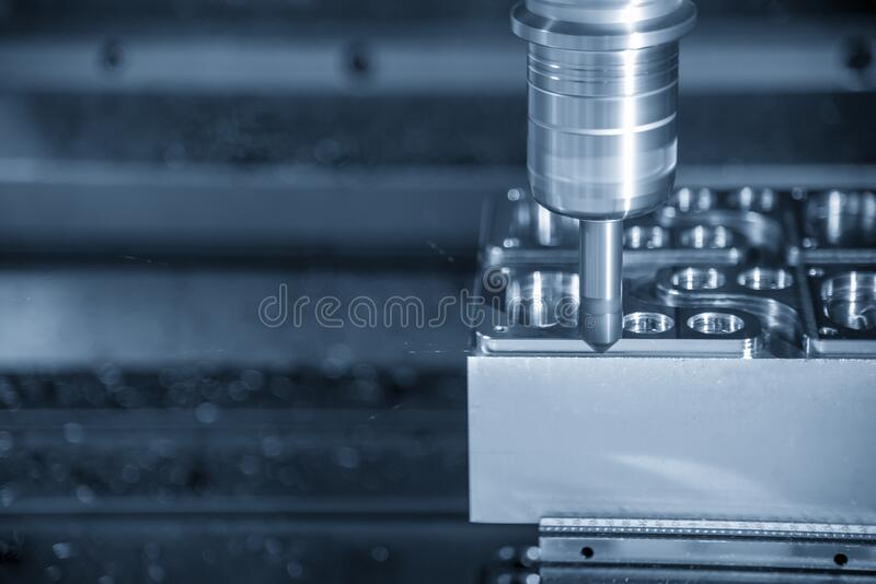 The CNC milling machine chamfer cut the injection mold parts by chamfer tools. The mold and die manufacturing process by machining center with the solid stock photo