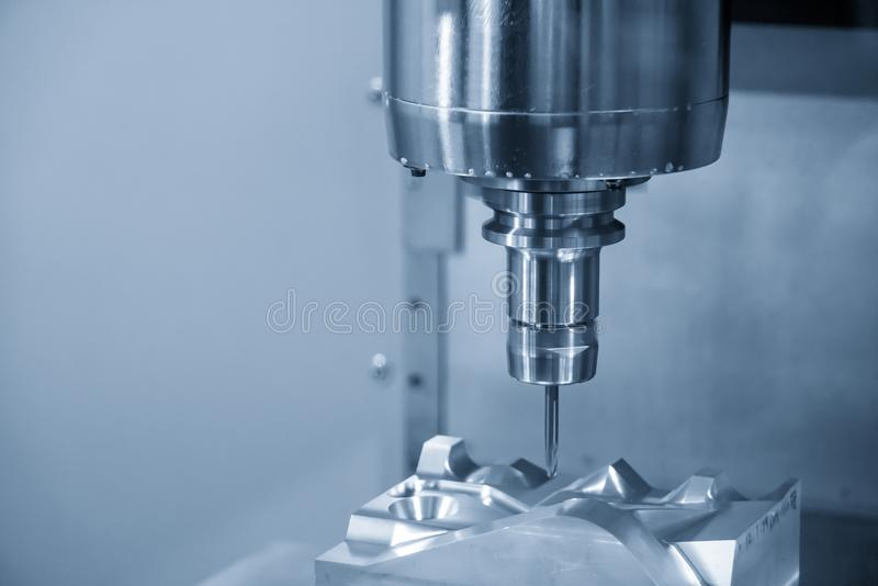 The CNC milling machine cutting the automotive mold part royalty free stock photos