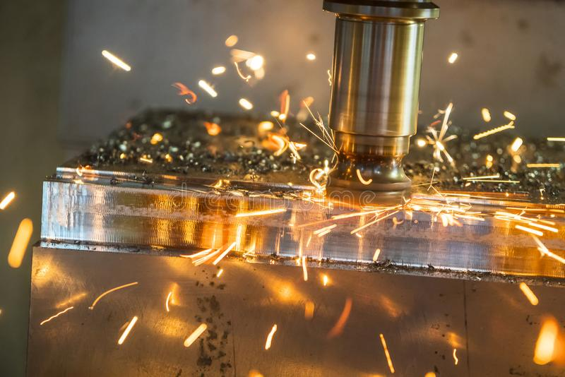 The CNC milling machine cutting the mold part . The CNC milling machine cutting the mold part in roughing process with the burning ship.Tool wear between royalty free stock photos