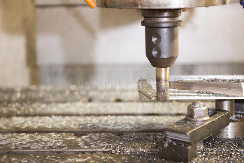 The CNC milling machine. Cutting the sample part with the cutting tool royalty free stock images