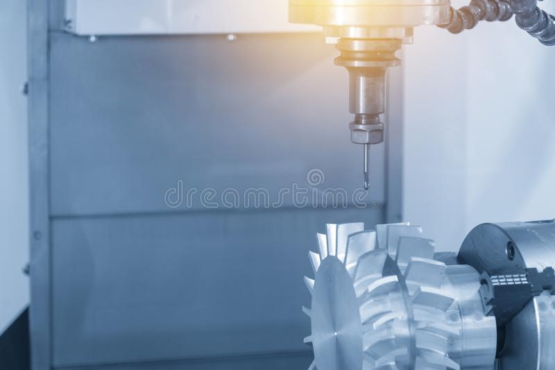 The CNC milling machine cutting turbine part royalty free stock photography