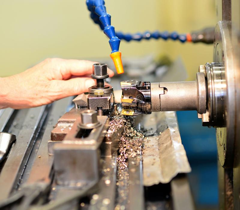 Cnc milling machine machining metal work piece in an industrial. Company for mechanical engineering royalty free stock photography
