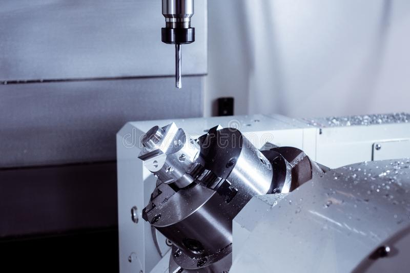 CNC milling machine during operation. Produce drill holes in the metal part stock images