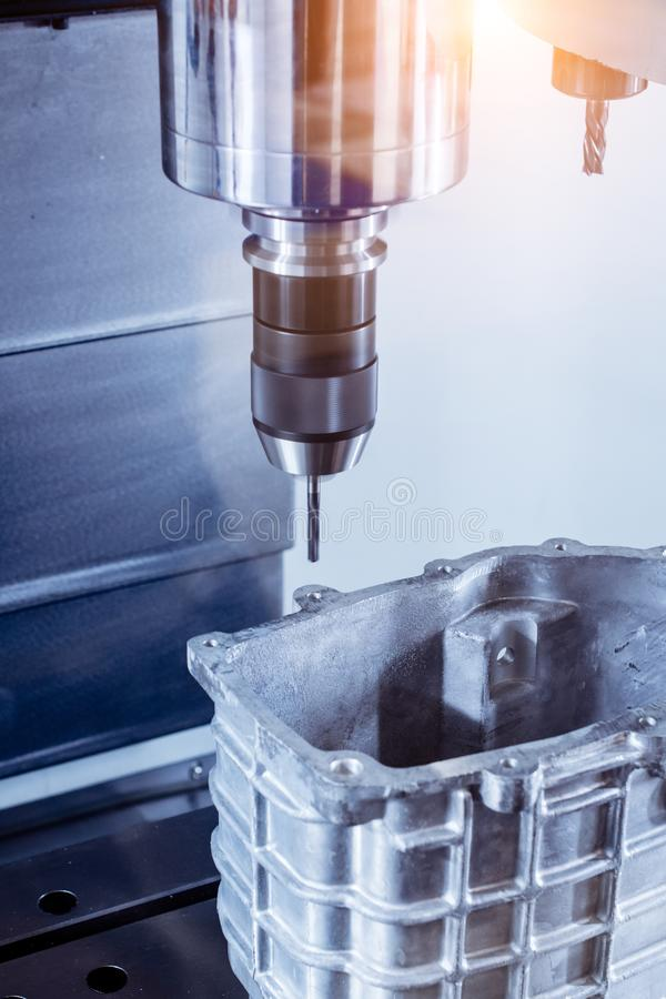 CNC milling machine during operation. Produce drill holes in the aluminium part royalty free stock photo