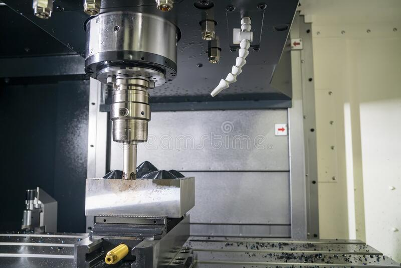 The CNC milling machine rough cutting the injection mold parts by indexable endmill tools. The CNC milling machine rough cutting  the injection mold parts by stock photo