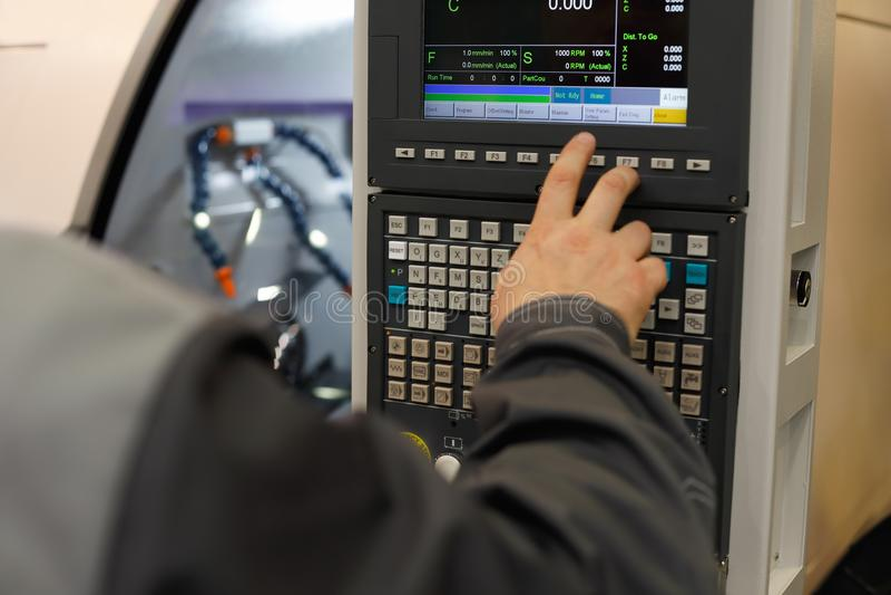 CNC operator programming lathe machine stock photos