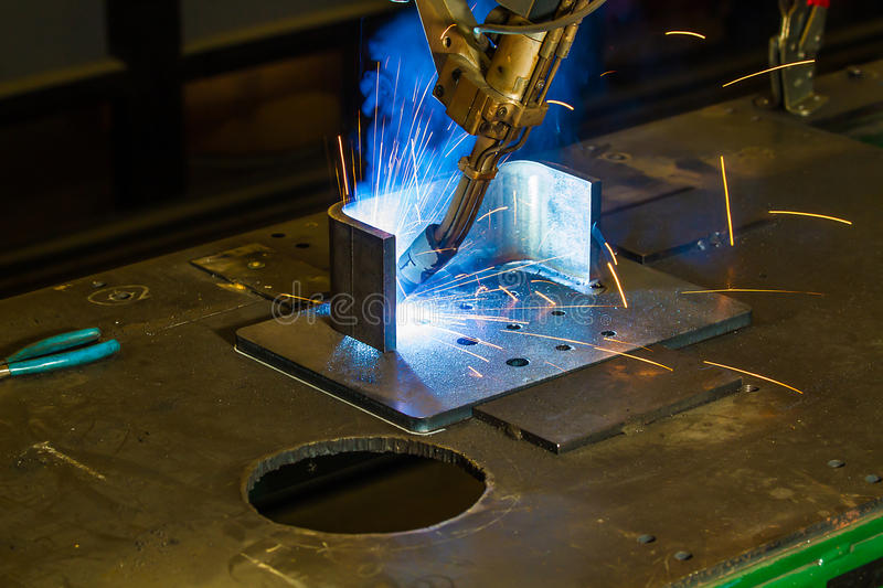 CNC robotic mig welding of half inch steel parts royalty free stock photography