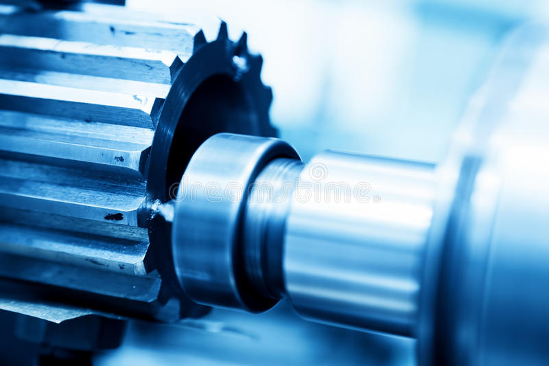 CNC turning, drilling and boring machine at work close-up. Industry, industrial concept stock images