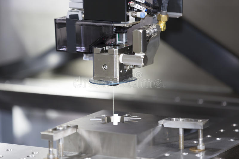 CNC wire cut machine cutting mold parts stock images